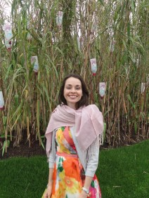 Charlotte surrounded by Ecover's sugar cane field