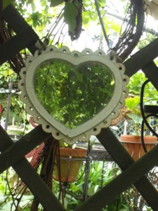 Heart-shaped garden mirror