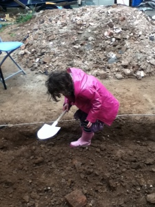 Child digging in the garden