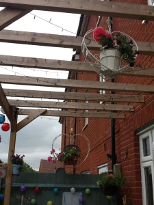 Pergola with hanging baskets in the garden