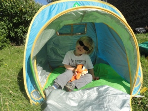 Child sleeping out in tent