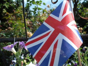 Union Flag waving in the sun in the garden