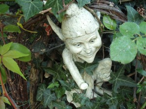 Broken gnome resting at the bottom of the garden