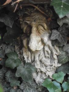 Gnarled Ivy Man Statue in Garden