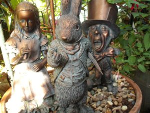 Alice in Wonderland, Mad Hatter, and Rabbit garden statues