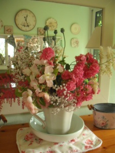 Dorothy Perkins rose, astibles and gypsophila flowers in a jug
