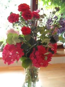 Rose Scarlet Cluster, Agapanthus, Echinops, Hydrangea flower arrangement