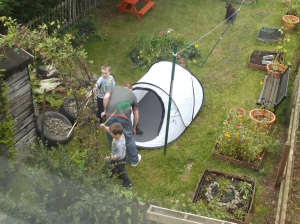 My husband and children putting up the tent.